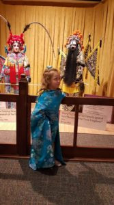 Elise, posing as a Chines opera performer, at the Indianapolis Children's Museum