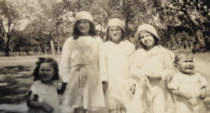 Faye is the one in the middle. This 1936 (or possibly 1937) photo includes her three sisters, and one other, unidentified girl.