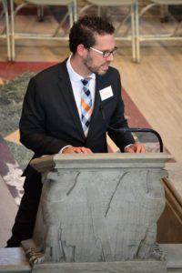 Charles at podium